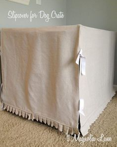 A dog crate of any size can be covered and hidden with a custom sewn slipcover, using canvas painter's drop cloths.