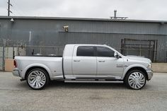 Custom Ram 3500 Truck Poses On Brushed Wheels