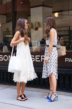 white flowy dress, black sandals, + bucket bag | get printed dress + blue statement heels