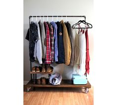 This is a great clothing rack for condo or townhome living. This clothing rack also includes a pipe leg shelf that not only adds dimension but increases your storage area. This rack is also a great addition to the guestroom for that occasional visitor. It is a heavy duty industrial design complete with old fashioned swivel steel wheels. The old sawmill plank base works well for shoe storage or a couple of suitcases. This versatile addition to your home may also function as a firewood rack…