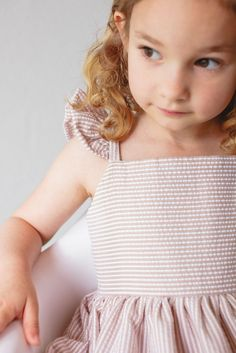 Bailey Dress // tan seersucker, perfect for Spring and Summer. Kids fashion at its finest.
