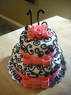 @Andie Pierce i want a chocolate tier cake for my birthday next year and i want chocolate icing how the whit it on this one and then i want the pink bows and roses. Pleasee i <3 you.