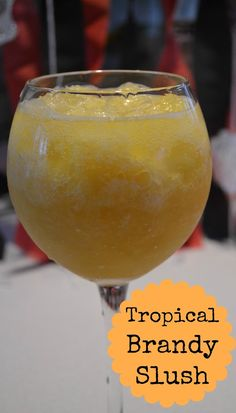 The perfect summer drink! Tropical Brandy Slush recipe from The Domestic Geek