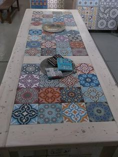 Patio table - kind of a shame to put such expensive tiles out in the weather though ...