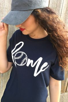 """Our Home Tee - Baseball Edition is a LaRue exclusive and features a navy blue super soft tee with the word """"home"""" printed in white on the front with a baseball as the letter """"o"""". Model is a size 2 and Baseball Tips, Baseball Mom, Baseball Shirts, Baseball Players, Baseball Stuff, Baseball Outfits, Baseball Treats, Baseball Sayings, Travel Baseball"""