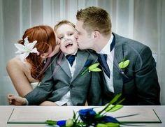 Bride and Groom's son at signing the registry, by Witney Weddings Photography