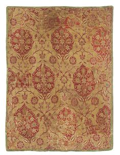 AN OTTOMAN SILK AND METAL-THREAD TEXTILE, TURKEY, 17TH CENTURY of rectangular form, woven with ochre and gilt threads, decorated with a cerise silk repeat pattern of composite floral heads on foliate stems including tulips, carnations and peonies, olive green and blue silk floral detailing, with old collection label to reverse written in Dutch which reads '496E/01, 18th Century Venetian Gold Brocade, RAI'   80 by 60cm.