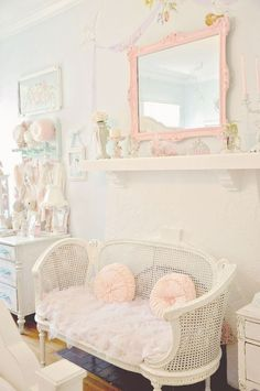 #Victorian shabby chic sitting room: white wicker bench and pink framed mirror.