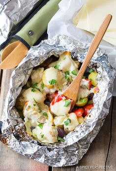 Cheesy Ranch Chicken Potato Foil Packets, a great dinner idea for camping, tailgating, and grilling in the park! Just a handful of ingredients, and foil to