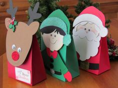 Holiday Treat Bags made with Cricut. Cut a bag out then adhere Reindeer, Santa and Elf faces on the bag. Christmas Treat Bags, Christmas Time, Christmas Decorations, Christmas Ornaments, Xmas Crafts, Crafts For Kids, Paper Crafts, Christmas Activities, Bricolage