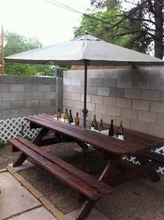 Rain gutter cool drink server built into a picnic table (add a downspout to drain the water out as the ice melts?)