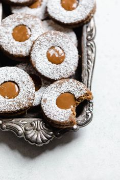 Santa, meet your new favorite cookie. Seriously obsessed with these Gingerbread Linzer Cookies with dulce de leche centers! Santa, meet your new favorite cookie. Seriously obsessed with these Gingerbread Linzer Cookies with dulce de leche centers! Holiday Baking, Christmas Baking, Christmas Cookies, Christmas Biscuits, Profiteroles, Cannoli, Brownies, Broma Bakery, Linzer Cookies