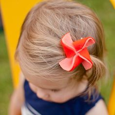 Learn how to make this adorable felt pinwheel! Attach them to an alligator clip or a headband for a fun hair accessory for your little one.