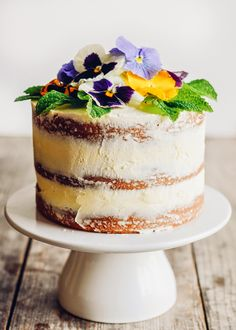 Triple Lemon Naked Layer Cake with Edible Flowers: Buttered Side Up... could cover with meringue instead too!