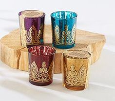 Sapphire, amethyst, ruby and citrine - these beautiful jewel tone colors come together in an exotic guest favor in Kate Aspen's Indian Jewel Henna votives, perfect for using to decorate your Moroccan themed wedding or Indian bridal shower.