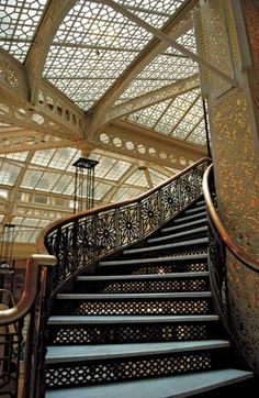 The Rookery Building Staircase in the Rookery (1886), a Chicago building designed by Daniel H. Burnham and John Wellborn Root. Frank Lloyd Wright renovated the lobby in 1905.