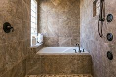 """I really loved this #wetroom #bathroomdesign - besides providing a """"carwash"""" experience with the multiple showerheads the built in tub looks like a perfect place to soak your cares away. I love that natural light abounds (because sometimes showers become dark corners with little light.) #listingfotos #realestate Interiors / Hospitality / Lifestyle / Real Estate photography at http://ift.tt/297bBJy"""