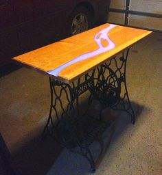 using casting resin with glow in the dark powder to fill in cracks in table.
