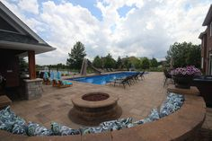 This is a 20 x 50 Rectangle Pool with a Coverstar Automatic Pool Cover installed in Frankfort, IL by Aqua Pools, Inc.