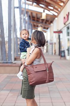 Motherhood is a job--invest in the gear that works. This leather backpack diaper bag transforms into a chic handbag when you drop your kids off, and comes with more than 21 pockets, a changing pad, and a removable, washable organization insert.