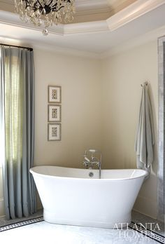 Freestanding bath in the corner. Corner bath tub. Corner freestanding bath. A skirted tub by Sunrise Specialty is placed in the corner of the master bath so as not to take up additional real estate in the room.