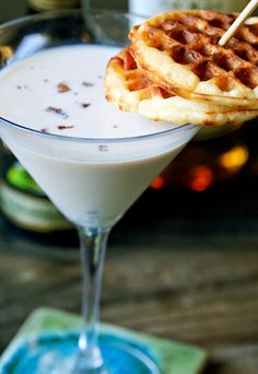 Maple Syrup Martini with Mini-Waffle Garnish - 1 ounce dark rum  2 ounces Irish Cream  1 teaspoon maple syrup  2 ounces milk  1/4 cup crumbled bacon bits