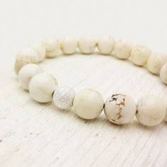 Love this white beaded bracelet that includes white turquoise and a single sparkly silver bead.