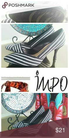 Striped canvas kitten heels in black and white NWOT heels in diagonal striped canvas material. I love them alas, not my size :) adorable with a dress or a skirt. Impo Shoes Heels