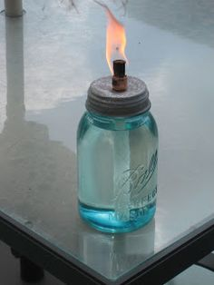 Girl with the Pink Toolbelt: DIY Mason Jar Oil Burner. I can also use old wine bottles.