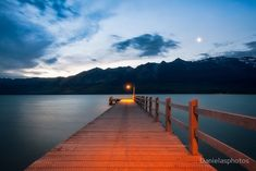 https://www.redbubble.com/people/danielasphotos/works/25958984 Moon rising at Glenorchy Wharf, New Zealand.