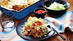 friday night nachos turn the classic appetizer into a filling dinner bake by loading a 13 x 9 pan with crushed tortilla chips and all of your favorite nacho toppings. Beef Recipes, Mexican Food Recipes, Dinner Recipes, Cooking Recipes, Ethnic Recipes, Recipies, Cooking Stuff, Quesadillas, Baked Nachos