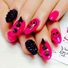 Hot pink and black studded skull nails without the pink