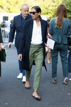 Love the look....Photo via: Vogue Australia Applauding this street style star's classic take on green utility pants! Her longline coat, collarless shirt, and chic flats give this look the perfect masculine-meets-femin
