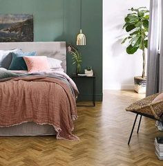 Earthy, organic colours are going to be big in 2018. Get ahead of the trend by pairing coral pink and deep greens, as shown here with Amtico Form Rural Oak.