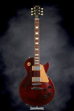 Gibson Les Paul Studio - 2014, Wine Red | Sweetwater.com | Solidbody Electric Guitar with Chambered Mahogany Body, Maple Top, Maple Neck, Rosewood Fingerboard, 2 Humbucking Pickups, and Premium Gig Bag - Wine Red