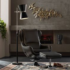 Relax in a pool of light with a perfectly placed floor lamp. Whether you're reading, working, or just taking it easy, everyone needs a best seat in the house. #floorlampforhome #livingroomdecorideas #blackreclinerideas #smallspaceinspiration #smallspacedecor #smallspaceideas #homelightingideas #livingroominspiration #smallspacesquad