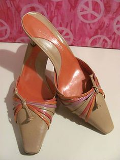 GIANNI BINI    WOMENS LEATHER MULES    SIZE 7M    MINT CONDITION    FOR PREOWNED    ORANGE & TAN    2 ¼ IN HEEL    LIGHTLY PADDED HEEL    VERY COMFY    SUPER STYLISH    WONDERFUL ADDITION    TO YOUR WARDROBE    SELLS FOR 59.00