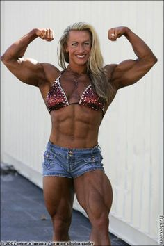 Sexy fitness goddess with strong muscles posing and flexing-966