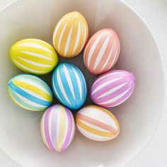 Soft pastel colors give these Easter eggs a seasonal feel! http://www.bhg.com/holidays/easter/eggs/pretty-no-dye-easter-eggs/?socsrc=bhgpin030615pastelstripedeggs&page=6
