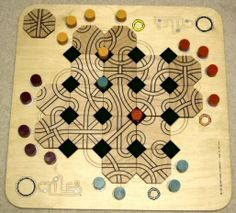 """The 18 all-different wood tiles have four paths each. Players join the tiles to create routes across the board as their five """"runners"""" race to the opposite side. Tiles move and paths change on every turn, creating a dynamic whirl of strategies."""