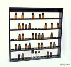 Hand crafted essential oil display shelf. Great for storing essential oils on a wall hanging storage rack. measures 24 in wide x 23 in tall x 2 1/2 in deep This beautiful shelf is made to hold 75 bottles of essential oils, 5 ml to 30 ml. With the round indents, you can rest assured the bottles will not slip or slide off your shelf. Additional storage on top for taller items Decorative moulding on top and bottom, give this shelf charm, but may be made without as well. Tongue and groove ...