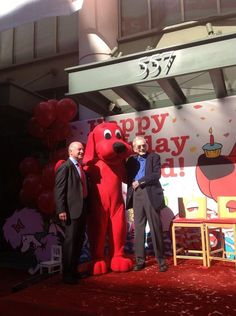 There's Scholastic CEO Dick Robinson (l) and Clifford creator Norman Bridwell (r), celebrating with Clifford!