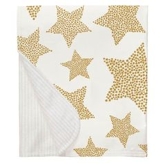 Mustard Galaxy Stars Crib Blanket made with care in the USA by Carousel Designs. Star Baby Blanket, Crib Blanket, Yellow Nursery, Free Fabric Swatches, Carousel Designs, Number Two, Repeating Patterns, Gold Stars, Cribs