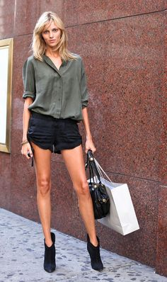 Anja Rubik doing model-off-duty like only a model-off-duty can (but we're taking inspo from her khaki shirt/black cut-offs combo)