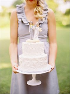 uhh, just the cutest personalized wedding cake topper we ever did see! you can get one here! http://www.etsy.com/shop/asimplestart?ref=seller_info