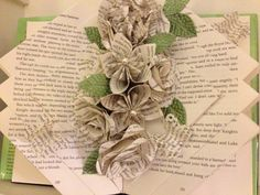 "This book ""sculpture"" I made for a friend. It's a simple, repetitive fold embellished with a variety of book flowers. The tutorial is on my main board, ""Book Art Tutorials""."
