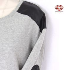 "GREY BLACK LEATHER PATCHED SWEATSHIRT TopShop grey sweatshirt with faux leather patches on shoulder and sleeves. Hip length with unfinished edges. 3/4 sleeves. Length: 25"". Armpit to armpit: 19.5"". Soft and stretchy. Very good condition. Size: 4 (label) Topshop Tops Sweatshirts & Hoodies"