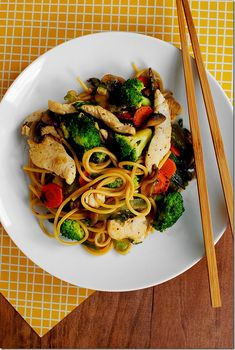 Stir fried vegetables and noodles are coated with a yummy sauce in Easy Chicken Lo Mein. Healthier and tastier than take out!  | iowagirleats.com