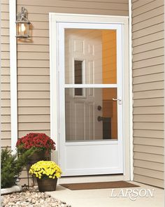 LARSON storm doors are built to protect what matters most. This white storm door offers & No cutting into your house for the doggie door! This LARSON storm ...