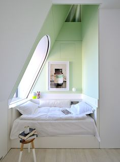 "Attic Nook: would actually like I see the before pic for this. Imagine it's proof of how a ""useless"" space becomes useful with the right treatment."